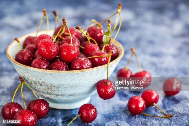 Fresh wet ripe  sour cherry in a bowl