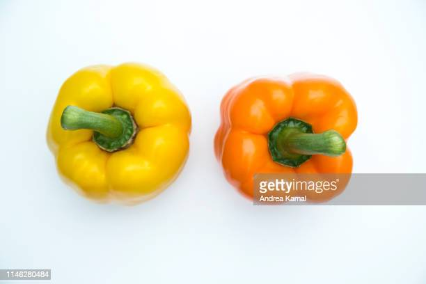 fresh yellow and orange bell pepper - yellow bell pepper stock pictures, royalty-free photos & images