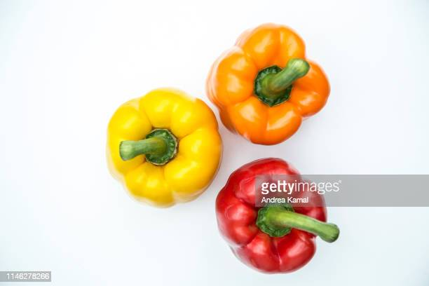 fresh yellow, orange and red bell pepper - paprika stock pictures, royalty-free photos & images
