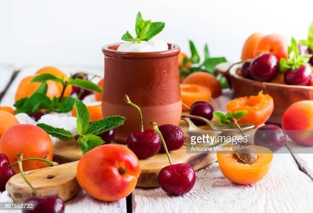 Fresh yogurt with organic ripe apricots and cherries