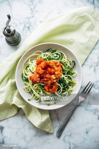 fresh zoodles with tomato sauce - marrow squash stock pictures, royalty-free photos & images