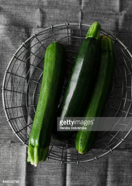 fresh zucchini in basket - zucchini stock pictures, royalty-free photos & images