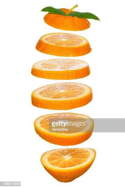 Fresh-Cut Orange Slices Tossed in the Air
