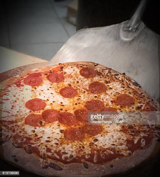 Freshed pepperoni pizza on spatula