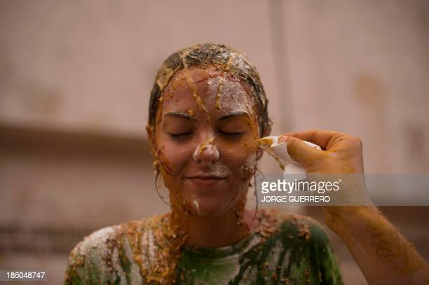 A fresher tries to clean the face of his friend during a hazing at the Faculty of Medicine of the University of Granada in Granada on October 17 2013...