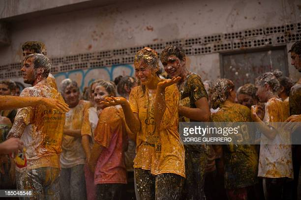 Freshers of the Faculty of Medicine are covered with food during a hazing at the University of Granada in Granada on October 17 2013 AFP PHOTO/ JORGE...