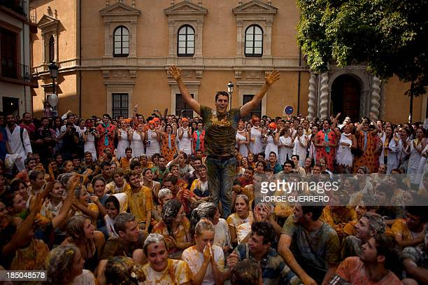 Freshers of the Faculty of Medicine covered with food sit during a hazing at the University of Granada in Granada on October 17 2013 AFP PHOTO/ JORGE...