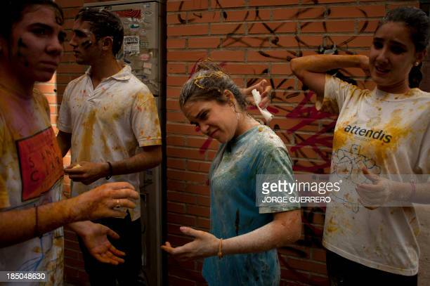 Freshers of the Faculty of Medicine try to clean themselves with tissue during a hazing at the University of Granada in Granada on October 17 2013...