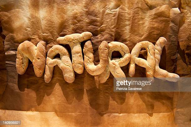 Freshly baked bread spelling out the word 'Natural