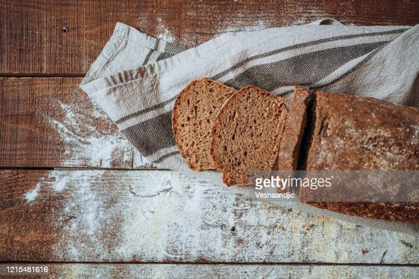 freshly baked bread, view from top - whole wheat stock pictures, royalty-free photos & images
