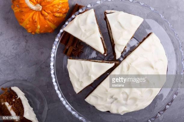 freshly baked butternut squash cake with  cream cheese frosting - icing stock pictures, royalty-free photos & images