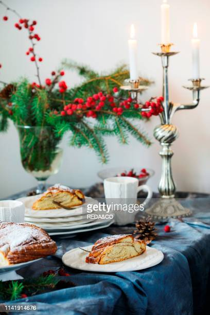 Freshly baked Cinnamon sweet Brioche Wreath on festive table