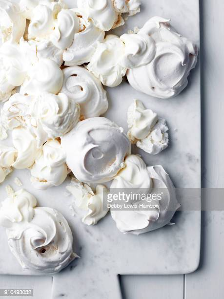 freshly baked meringues, overhead view - meringue stock pictures, royalty-free photos & images