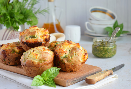Freshly baked muffins with spinach, sweet potatoes and feta cheese on white background. Healthy food concept. Savory pastry. 1132732027