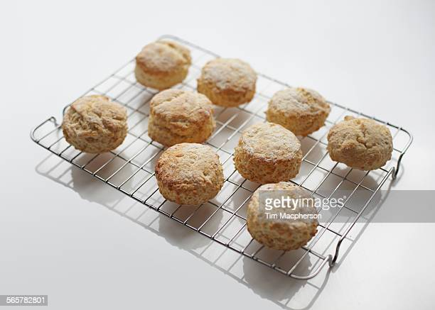 freshly baked scones on cooling rack - cooling rack stock photos and pictures
