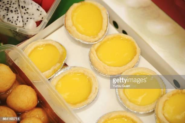 freshly baked tarts, macao tart, portuguese egg tart. - golden egg restaurant stock pictures, royalty-free photos & images