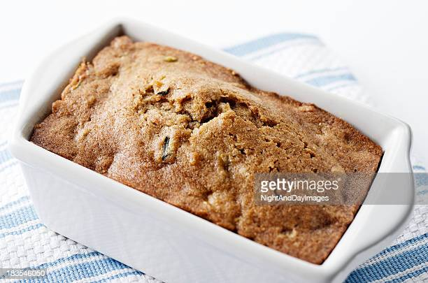 Freshly baked zucchini bread in a white container