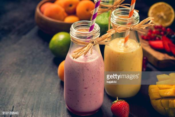 freshly blended fruit smoothies - milkshake stock photos and pictures