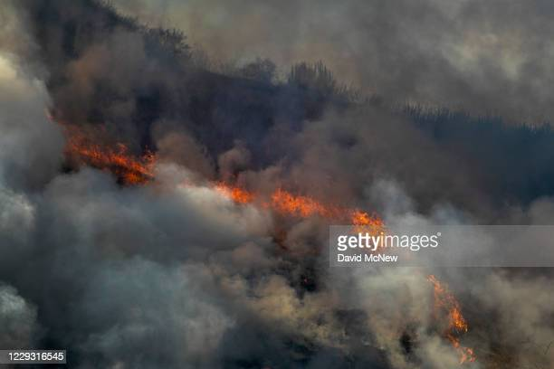 Freshly burned hillside smolders during the Blue Ridge Fire on October 27, 2020 in Chino Hills, California. Strong Santa Ana Winds gusting to more...