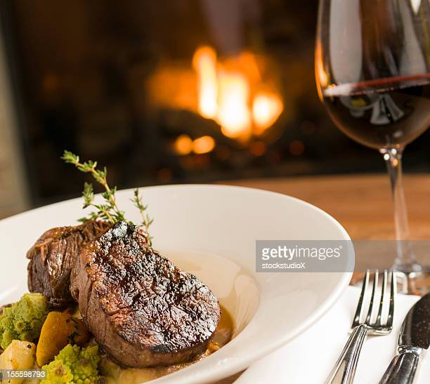 freshly cooked beef tenderloin in a white bowl with red wine - steak stock pictures, royalty-free photos & images