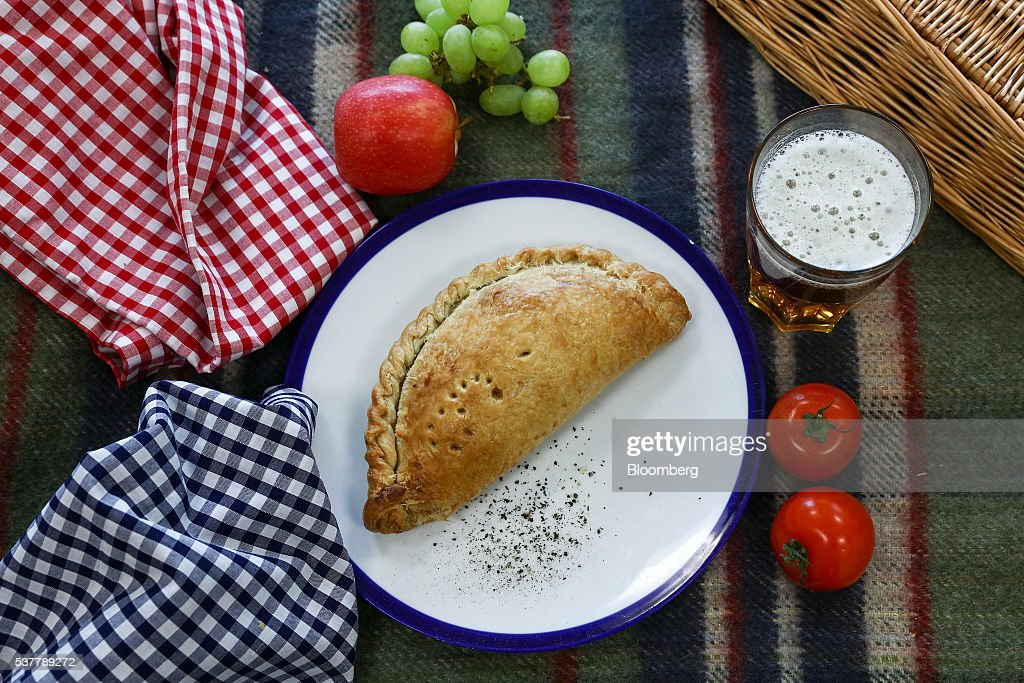 A freshly cooked Cornish Pasty sits on a table at Cornish Premier Pasties Ltd. in this arranged photograph in St Columb, Cornwall, U.K., on Thursday, April 28, 2016. Cornish Pasties are one of the U.K.'s food products that are protected against imitation throughout the European Union under regulations that recognize regional and traditional foods. Photographer: Simon Dawson/Bloomberg via Getty Images