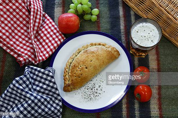 Freshly cooked Cornish Pasty sits on a table at Cornish Premier Pasties Ltd. In this arranged photograph in St Columb, Cornwall, U.K., on Thursday,...