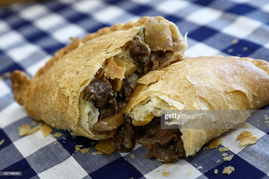 A freshly cooked Cornish Pasty sits on a table at the Cornish Premier Pasties Ltd. in this arranged photograph in St Columb, Cornwall, U.K., on Thursday, April 28, 2016. Cornish Pasties are one of the U.K.'s food products that are protected against imitation throughout the European Union under regulations that recognize regional and traditional foods. Photographer: Simon Dawson/Bloomberg via Getty Images