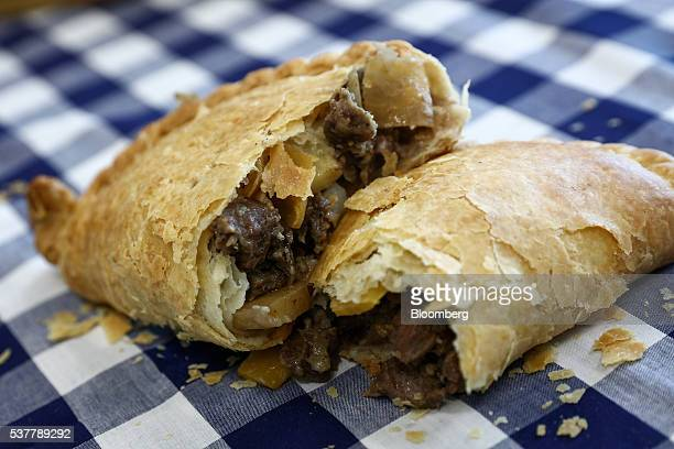 Freshly cooked Cornish Pasty sits on a table at the Cornish Premier Pasties Ltd. In this arranged photograph in St Columb, Cornwall, U.K., on...