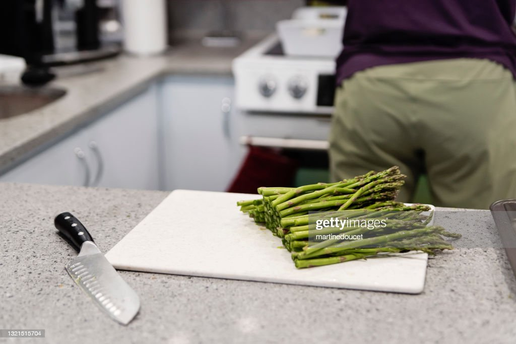 Freshly cut asparagus on kitchen counter. : Stock Photo