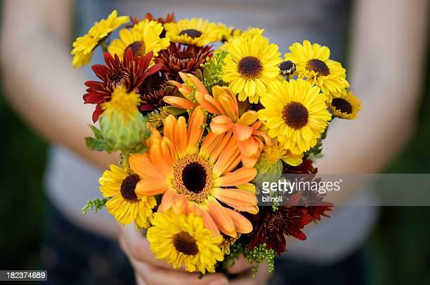 Freshly cut flowers in woman's hand