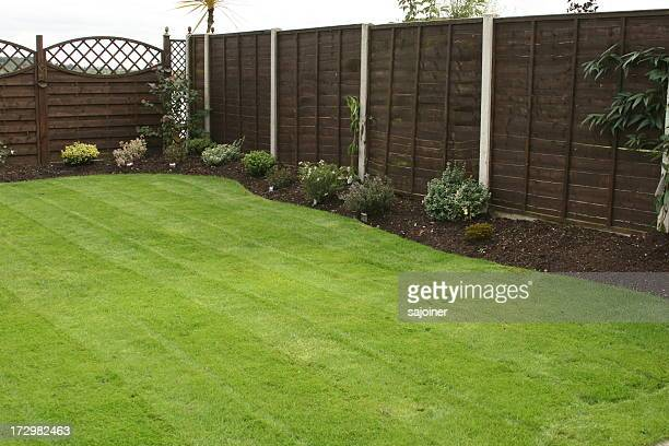 freshly cut grass - fence stock pictures, royalty-free photos & images