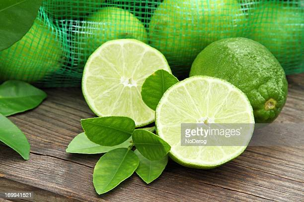 Freshly cut lime arranged on wooden table