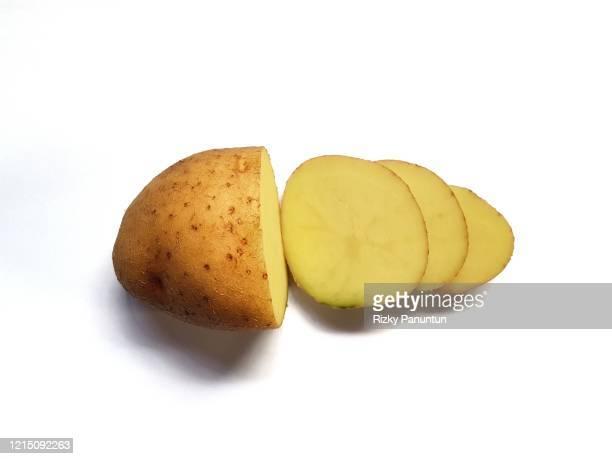 freshly cut potato isolated on white background - ジャガイモ料理 ストックフォトと画像