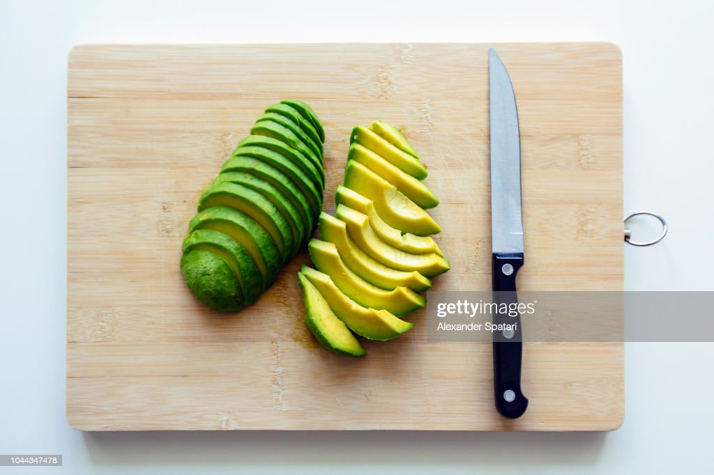Freshly cut sliced avocado on a cutting board : ストックフォト