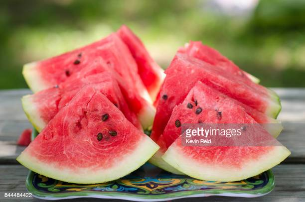 freshly cut watermelon slices - watermelon stock pictures, royalty-free photos & images