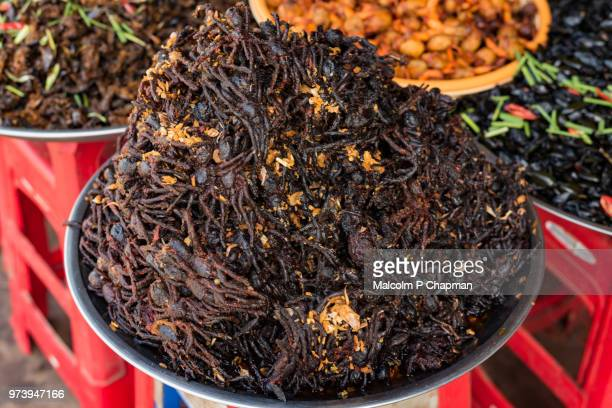 "freshly deep fried tarantulas, on sale at market stall, skuon, cambodia - cambodia ""malcolm p chapman"" or ""malcolm chapman"" stock pictures, royalty-free photos & images"