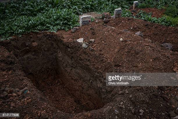 A freshly dug grave is seen ahead of a funeral at the small section of the Kilis Cemetery used to bury Syrian refugees on March 4 2016 in Kilis...