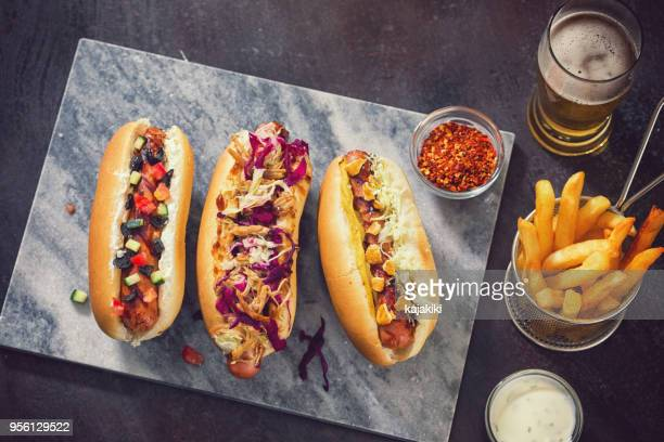 freshly grilled hot dogs - kalamata olive stock photos and pictures