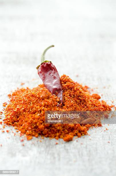 Freshly ground chili on a wooden table