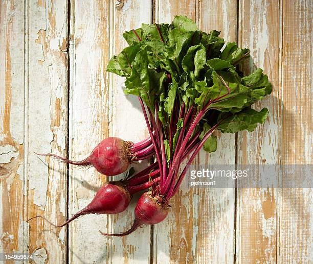 Freshly harvested beets on wood