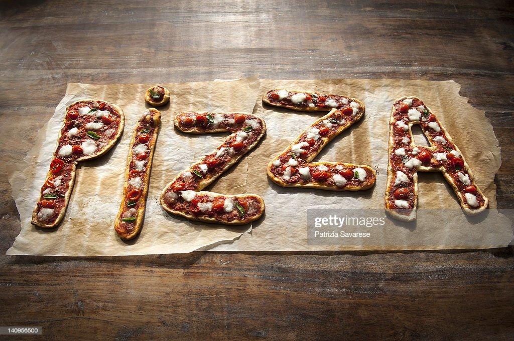 Freshly made Pizza spelling out the word 'pizza' : Stock Photo