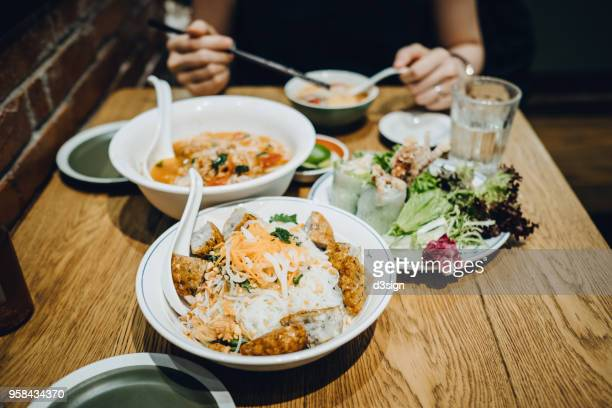 freshly made thai gourmet served on table in restaurant - thai food stock pictures, royalty-free photos & images