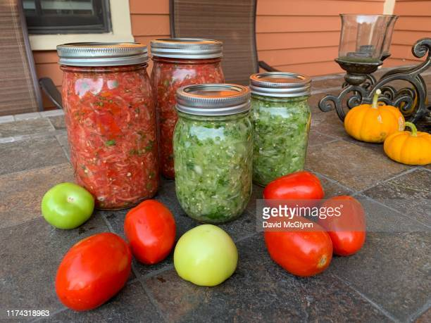 freshly made tomato salsa and tomatillo salsa verde - david canning stock pictures, royalty-free photos & images