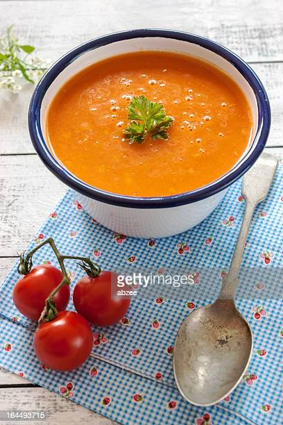 freshly made tomato soup in blue and white bowl - tomato soup stock photos and pictures