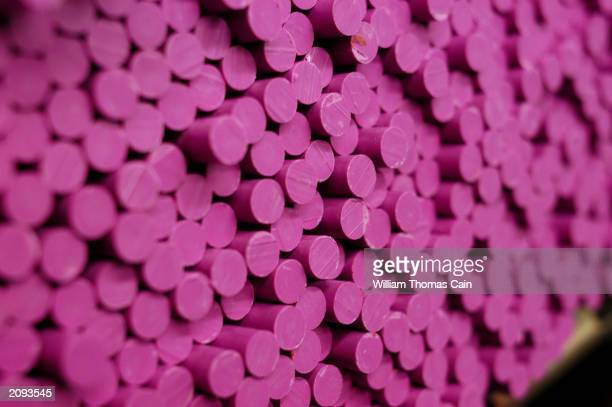 Freshly molded lavender crayons await labels at Binney and Smith Inc the manufacturer of Crayola crayons June 18 2003 in Easton Pennsylvania Binney...