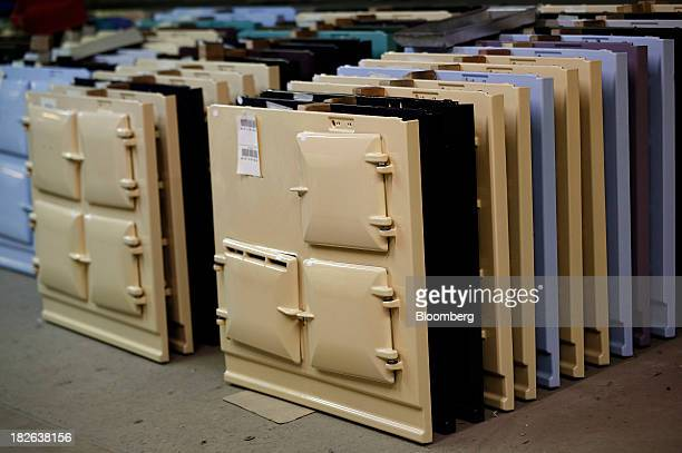 Freshly painted cast iron front panels of AGA and Rayburn range cookers produced by AGA Rangemaster Plc stand stored ahead of assembly at the...