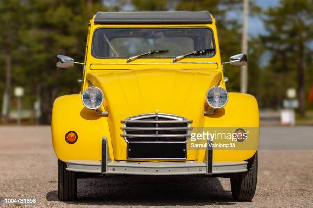 freshly painted citroen 2cv in parking lot - old car stock pictures, royalty-free photos & images