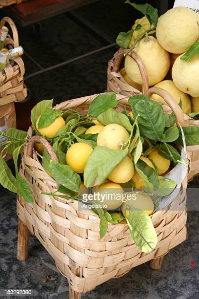 freshly picked lemons in a basket - sorrento stock pictures, royalty-free photos & images