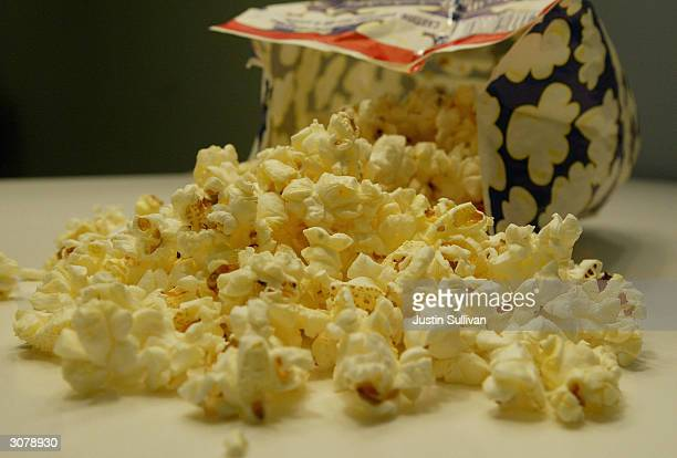 A freshly popped bag of microwave popcorn sits on a table March 12 2004 in New York City The Environmental Protection Agency is studying the...