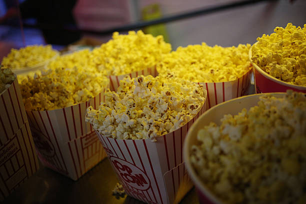 Freshly popped popcorn is displayed for sale inside the snack bar at the Georgetown DriveIn movie theater in Georgetown Indiana US on Friday July 17...